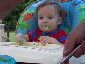 Obligatory Baby Eating Cake on His First Birthday Picture