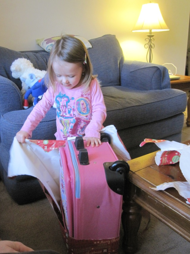 12-22-12 M opening suitcase