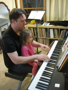 1-31-13 M and Dad play piano