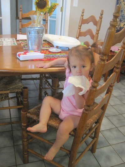 Here's our little climber after getting herself up on the chair to reach a paper towel on the table.